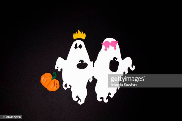 two festive ghosts fly witch holiday