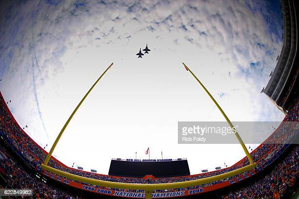 Two fighter jets perform a flyover before the game between the Florida Gators and the South Carolina Gamecocks at Ben Hill Griffin Stadium on...