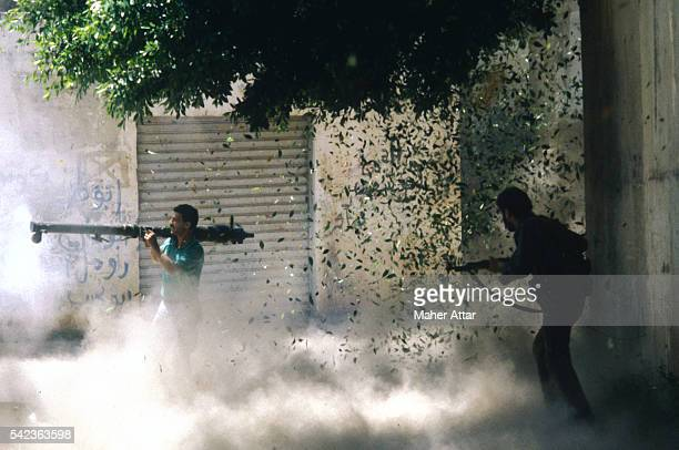 Two fighters during combat between the Hezbollah and Amal militia.