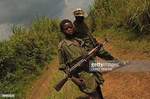 Two fighters of the Patriotic Force of Resistance for Ituri militia stand guard 28 July 2006 near Tchei south Ituri The UN is pushing for a full...
