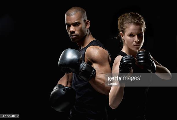 Two fighters posing with raised fists