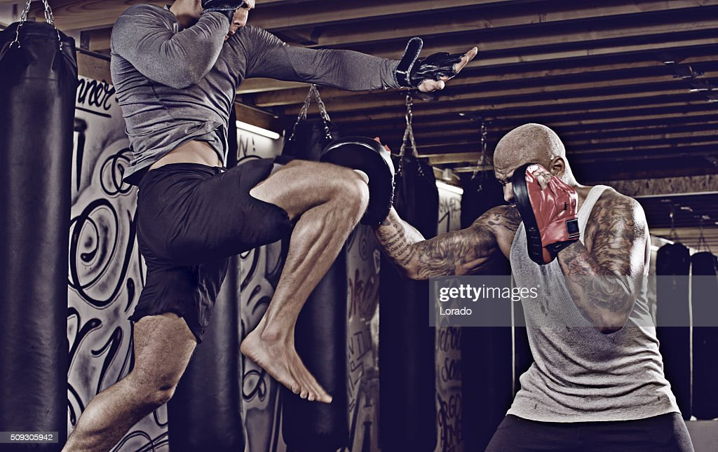 Two fighters sparring at an urban boxing gym : Stock Photo