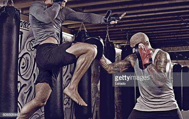 two fighters sparring at an urban boxing gym - mixed martial arts stockfoto's en -beelden