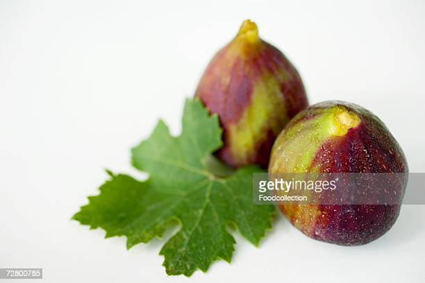Two figs with leaf