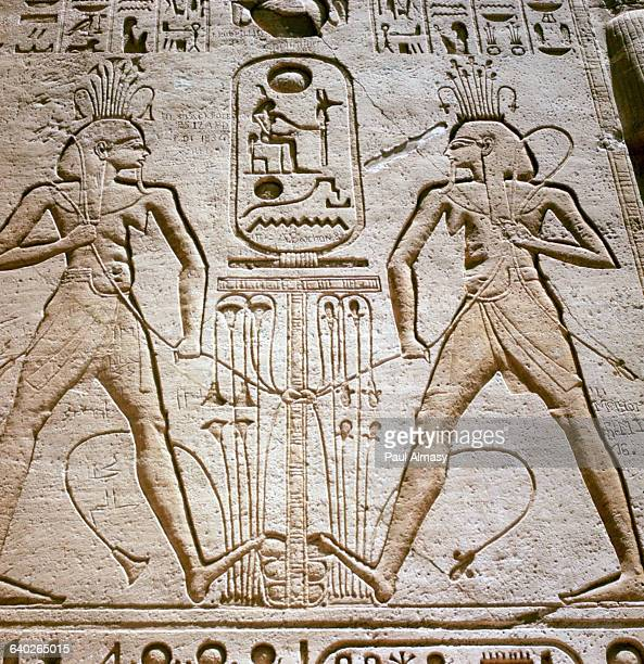 Two Figures of the Nile God Hapi Tying Upper and Lower Egypt Kingdoms