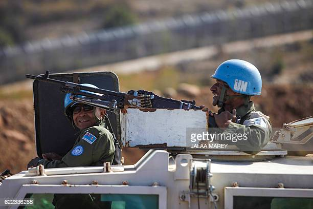 Two Fijian peacekeepers from United Nations Disengagement Observer Force smile from an APC as they monitor the border after crossing from the...