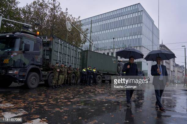 Two finance ministry workers pass by one of the security barriers placed by the government on October 16 2019 in The Hague Netherlands A...