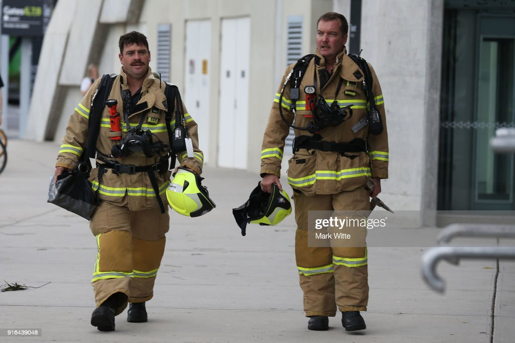Two fire fighters walk towards the fire control room at AAMI Park before the round 20 A-League match between Melbourne City and Sydney FC at AAMI Park on February 10, 2018 in Melbourne, Australia.