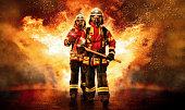 Two firefighters go through the fire