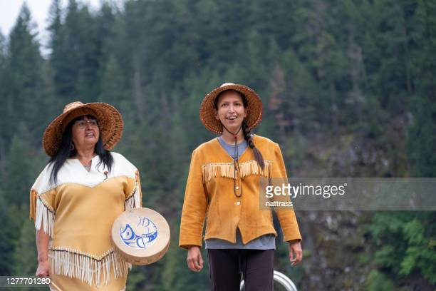 two first nations women in traditional clothing - inuit stock pictures, royalty-free photos & images