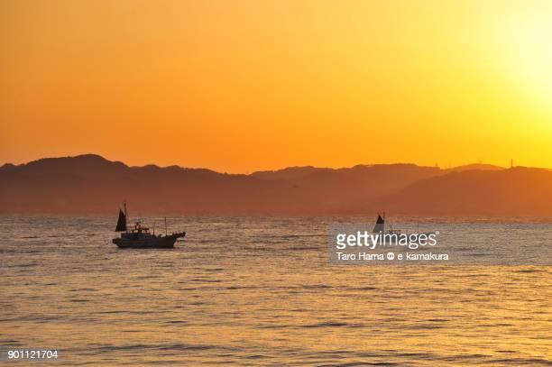 Two fisher boats and rising sun on Miura Peninsula and Sagami Bay in Kanagawa prefecture in Japan