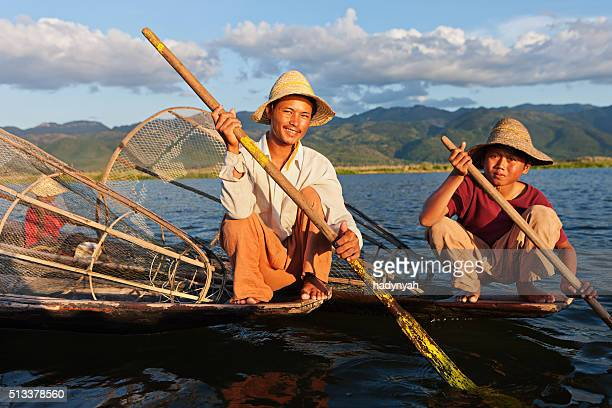 Two fishermen on Inle Lake, Myanmar