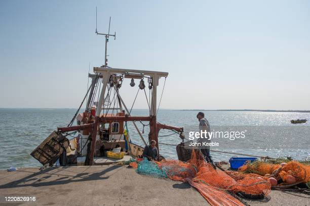 Two fishermen prepare their boat Lilley G to head out to fish for Dover Sole on April 24 2020 in Leigh on Sea England The UK fishing sector has been...