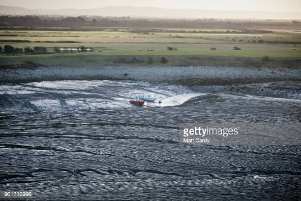 Two fishing boats are pictured at low tide in Clevedon on January 4 2018 in North Somerset England According to the property website Zoopla house...