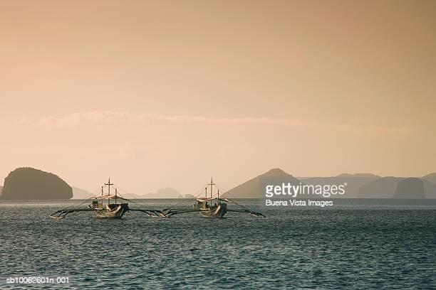 Two fishing boats in sea
