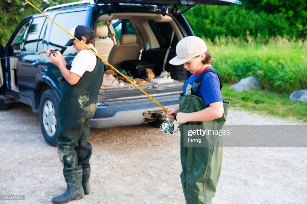Two fishing brothers getting ready to go fishing. : Stock Photo