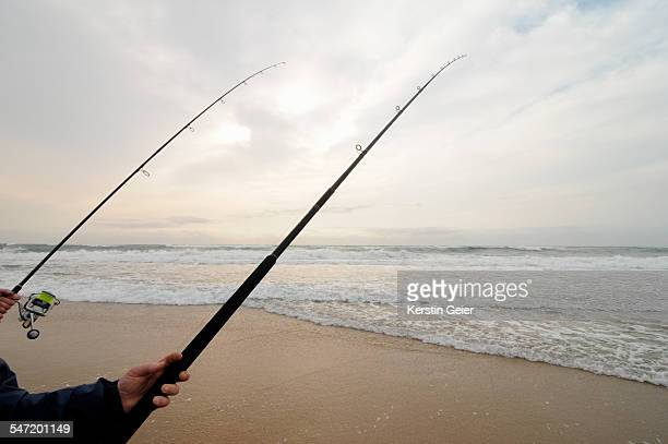 Two fishing rods and beach. St. Lucia, Kwa-Zulu-Natal, South Africa.