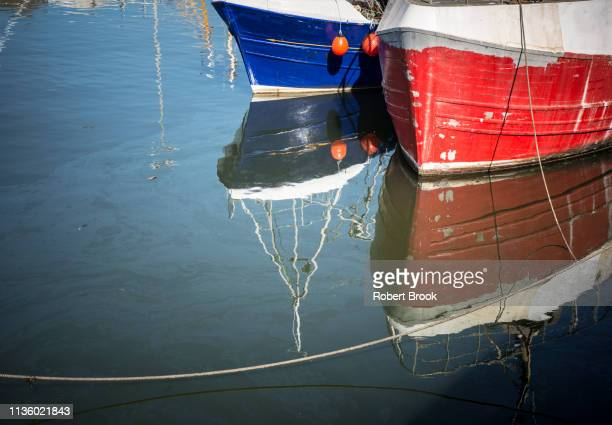 two fishing trawlers and reflections - fishing boat stock pictures, royalty-free photos & images