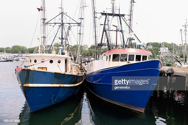 Two Fishing Trawlers tied up at dockside in Gloucester