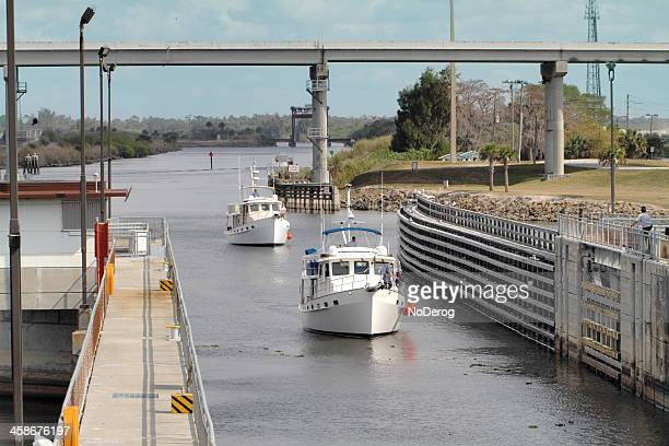 two fishing yatchs enter the port mayaca lock and dam - lake okeechobee stock pictures, royalty-free photos & images