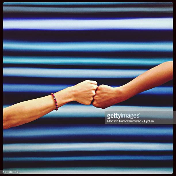 two fists facing each other - fist bump stock pictures, royalty-free photos & images