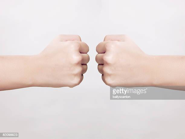 two fists facing each other (digital composite)