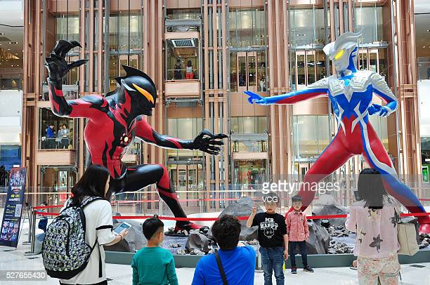 Two fivemetertall Ultraman models are displayed in a shopping mall on May 3 2016 in Shanghai China As part of an exhibition commemorating 50th...