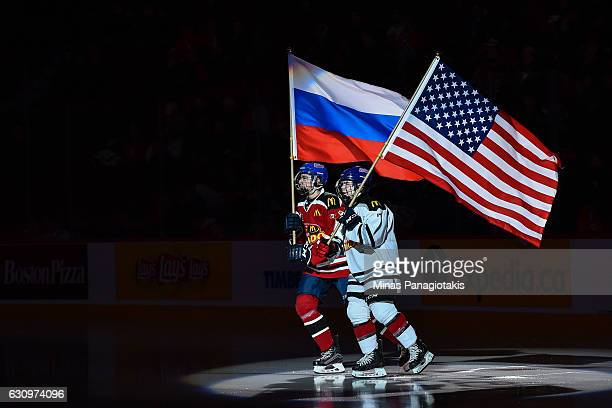 Two flag bearers skate with the United States flag and the Russian flag during the pregame ceremony prior to the 2017 IIHF World Junior Championship...
