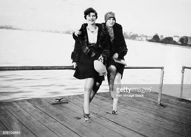 Two flapper women pose on a dock ca 1925