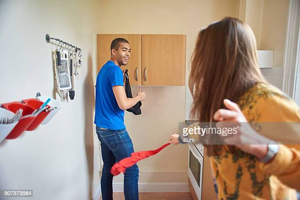 two flatmates goofing around - women whipping men stock photos and pictures