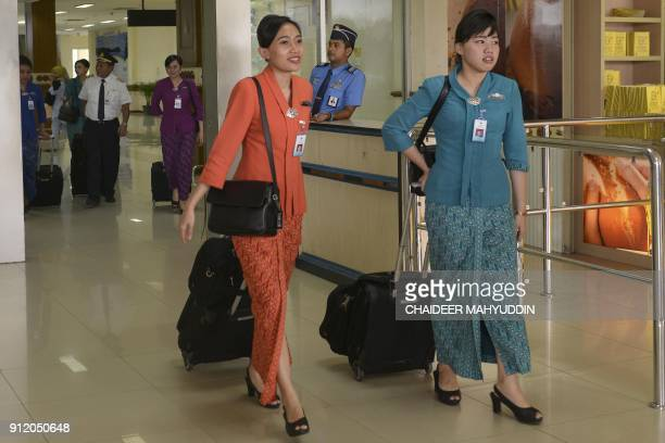 Two flight attendants arrive at the Sultan Iskandarmuda international airport in Aceh on January 30 2018 An Indonesian province said it is ordering...