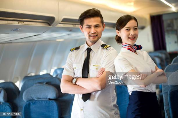 two flight attendants in the cabin - 乗員 ストックフォトと画像