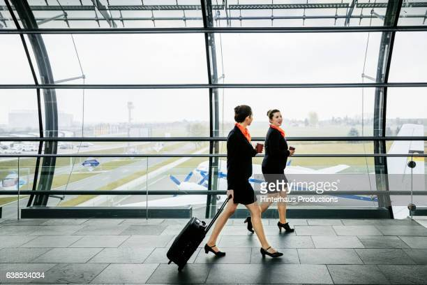 Two flight attendants on the way to their plane