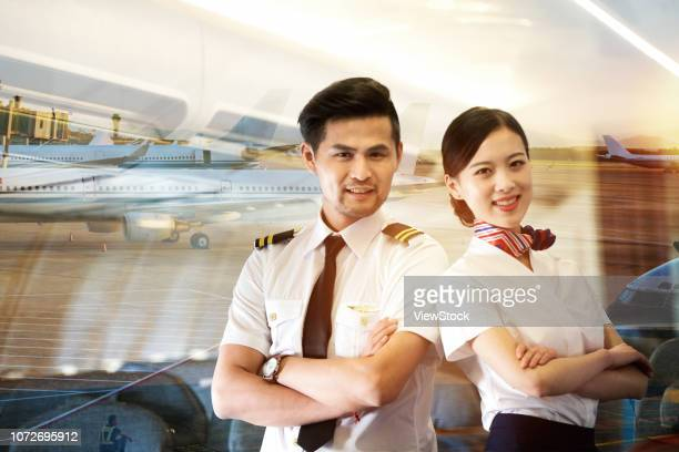 two flight attendants - 乗員 ストックフォトと画像