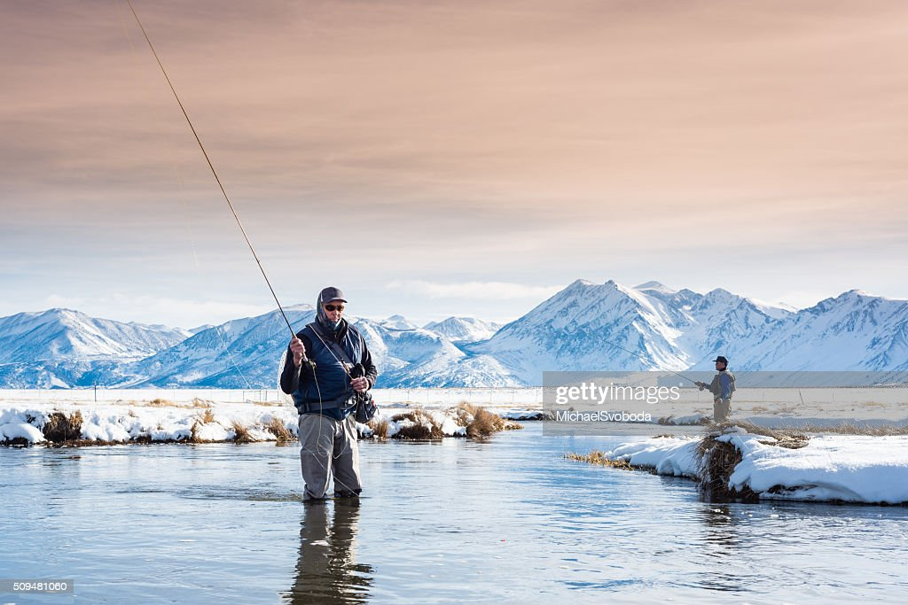 Two Fly Fisherman In The River During Winter : Stock Photo