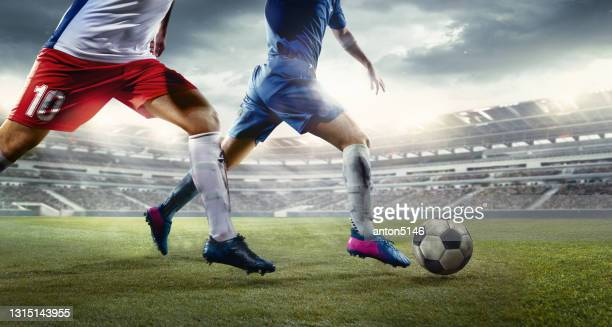 two football or soccer players in action at stadium in flashlights. - the championship football league stock pictures, royalty-free photos & images
