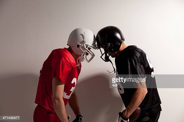two football players - confrontation stock pictures, royalty-free photos & images