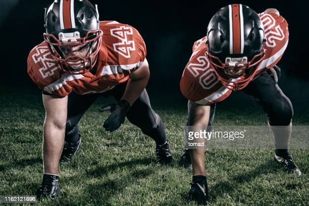 two football players starting position - safety american football player stock pictures, royalty-free photos & images
