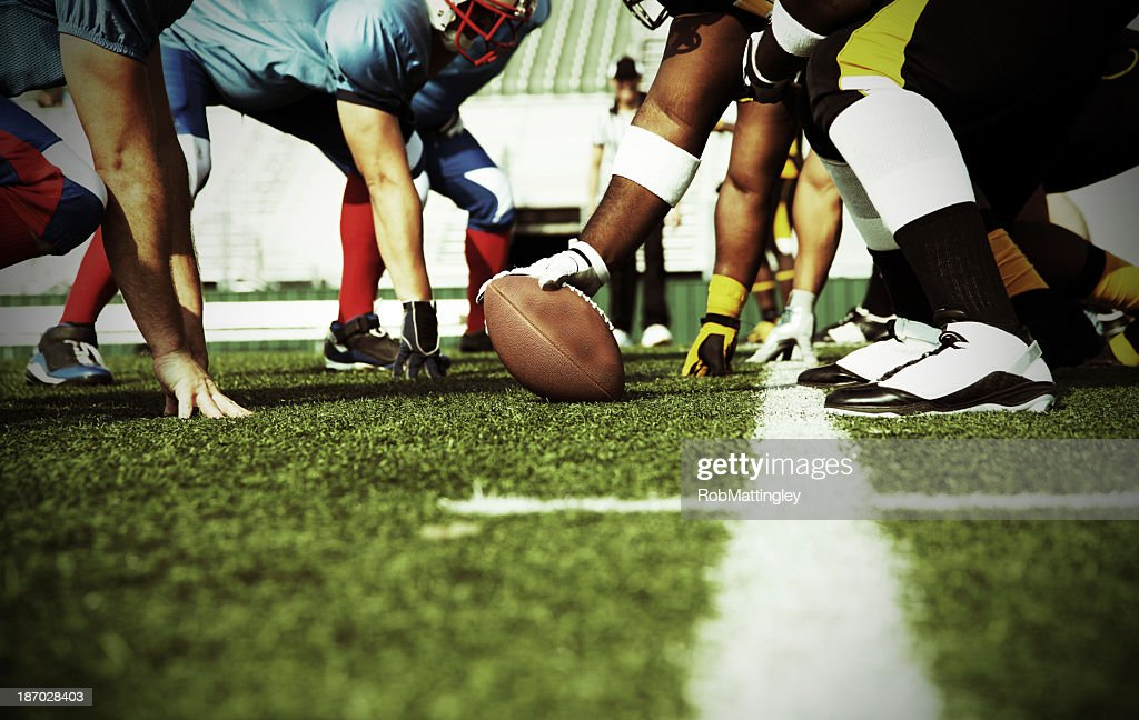 Two Football Teams Meet At The Line of Scrimmage : Stock Photo