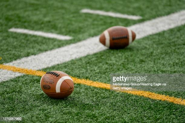 Two footballs on the side of the field. At Gov. Mifflin High School Stadium in Shillington, PA Monday afternoon August 31, 2020 for the first day of...