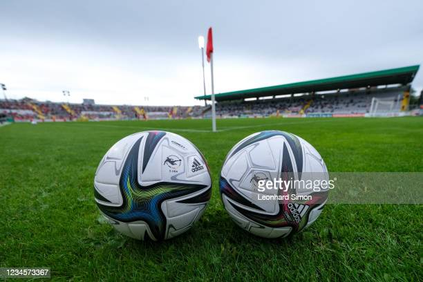 """Two footballs with the imprint """"3. Liga"""" are lying on the playground during the half-time break during the DFB Cup first round match between Türkgücü..."""