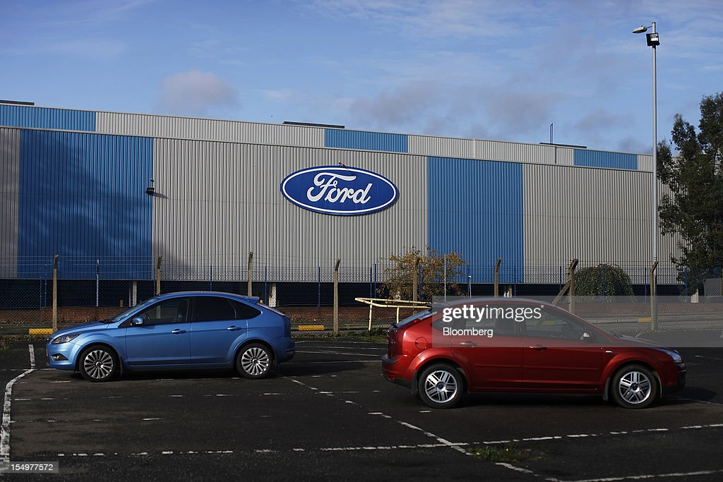 Two Ford Focus vehicles stand in a parking lot outside stamping operations area at the Ford Motor Co. automobile plant in Dagenham, U.K., on Monday, Oct. 29, 2012. Ford Motor Co. will shut three European plants, its first factory closings in the region in a decade, and cut 5,700 jobs to stem losses that the carmaker predicts will total more than $3 billion over two years. Photographer: Simon Dawson/Bloomberg via Getty Images
