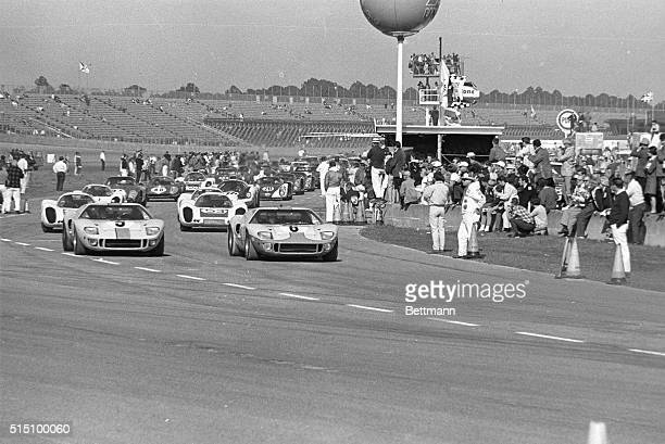 Two Ford GT40s followed by four Porsche 907 prototypes lead the field of 64 cars as they thunder toward the green flag which signaled the start of...