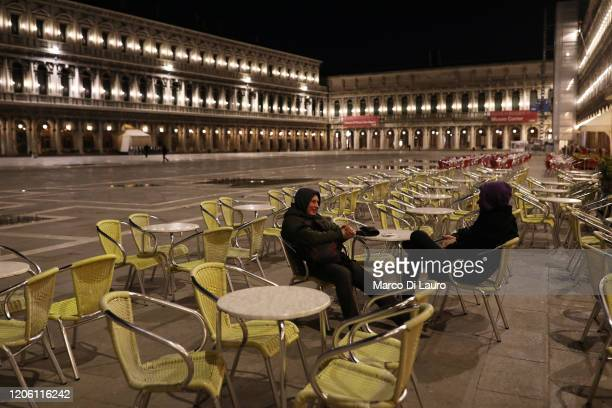 Two foreign tourists talks to each other in a completely empty San Marco Square on March 8, 2020 in Venice, Italy. Prime Minister Giuseppe Conte...