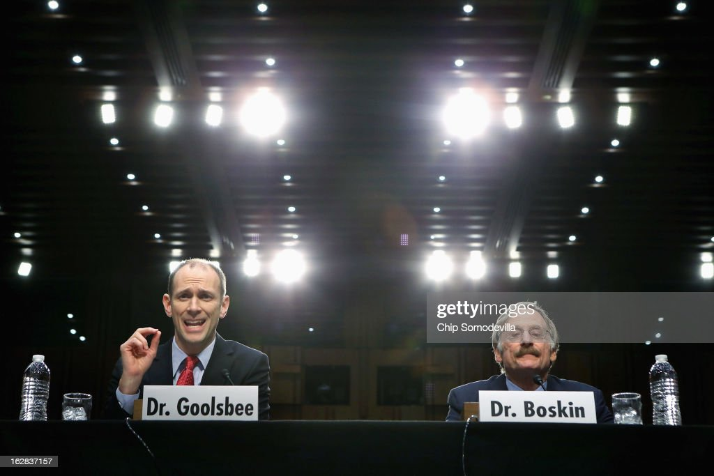Two former chairmen of the Council of Economic Advisers, Austan Goolsbee (L) and Michael Boskin testify before the Congressional Joint Ecoomic Committee on Capitol Hill February 28, 2013 in Washington, DC. Now economics professors, Boskin and Goolsbee disagreed on the speed of the nation's economic recovery during the hearing, titled 'State of the U.S. Economy.'