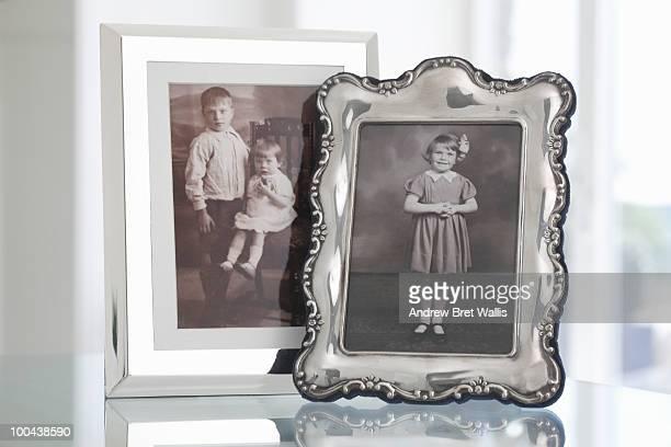 two framed vintage family photographs of children