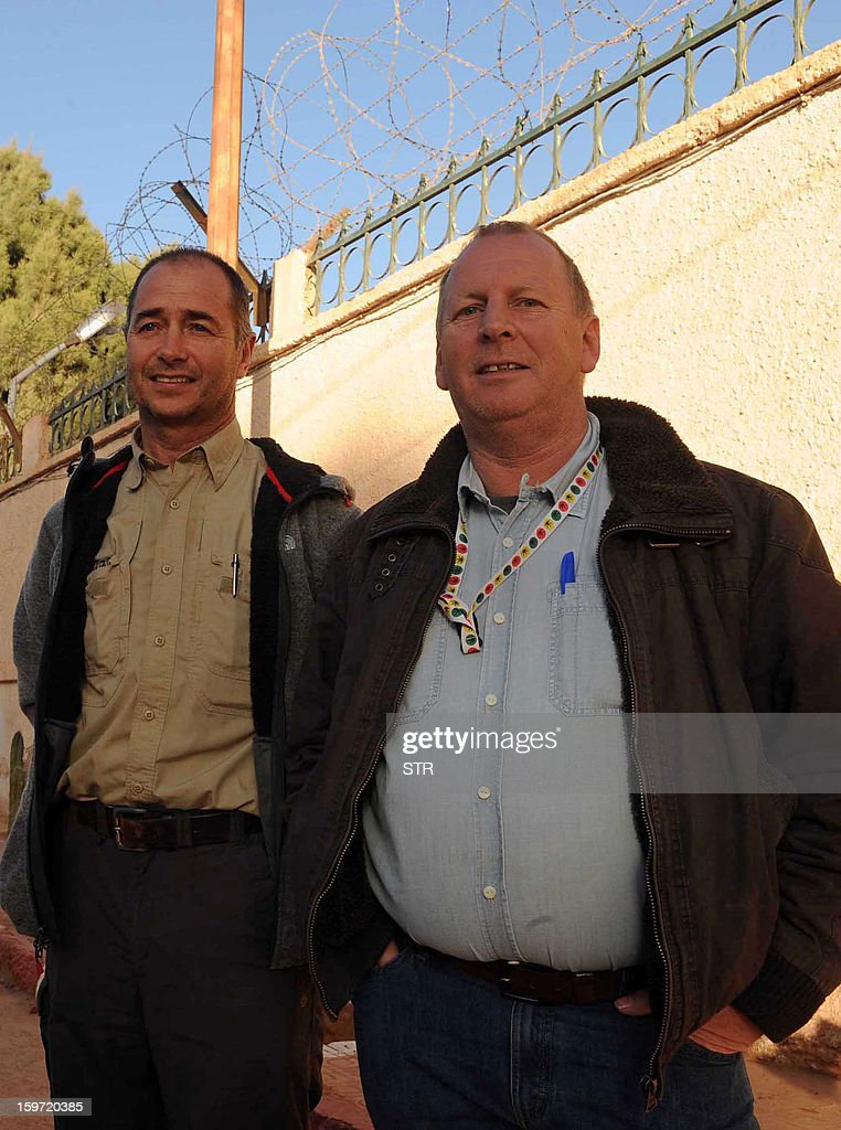 Two freed British hostages identified as Peter (R) and Alan stand outside a police station in In Amenas in the desert in Algeria's deep south on January 19, 2013. Islamists killed all seven of their remaining foreign captives before being gunned down at a gas plant in the Algerian desert, state media said, ending one of the bloodiest international hostage crises in years.