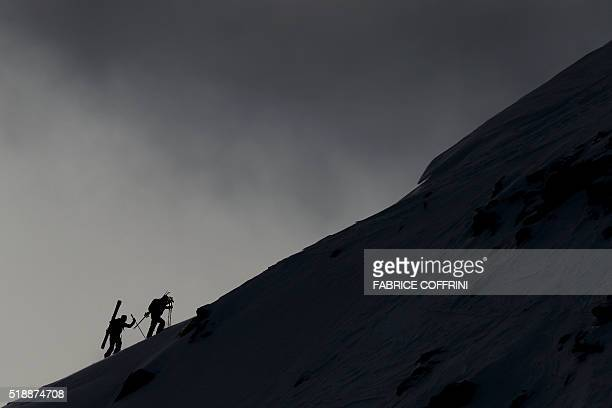 Two freeriders climb a windswept Bec des Rosses mountain to compete the men's ski event at the Verbier Xtreme Freeride World Tour final on April 3...