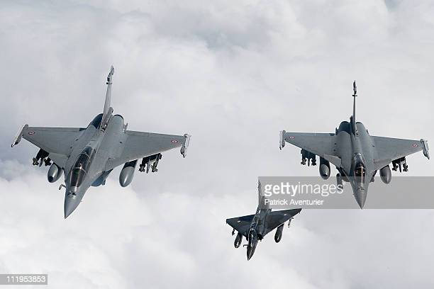 Two French air force Rafale jets and one Mirage 2000 fighter jet fly over the Mediterranean sea during the air operation 'Harmattan' April 9 2011...