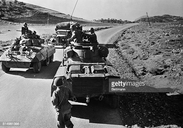 Two French armored vehicles conduct patrols in rural Algeria